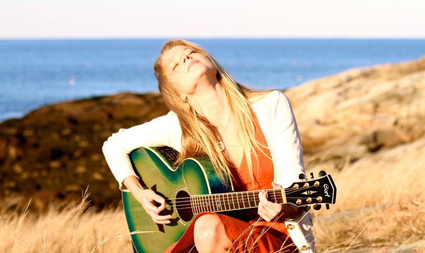 Marina Playing Guitar